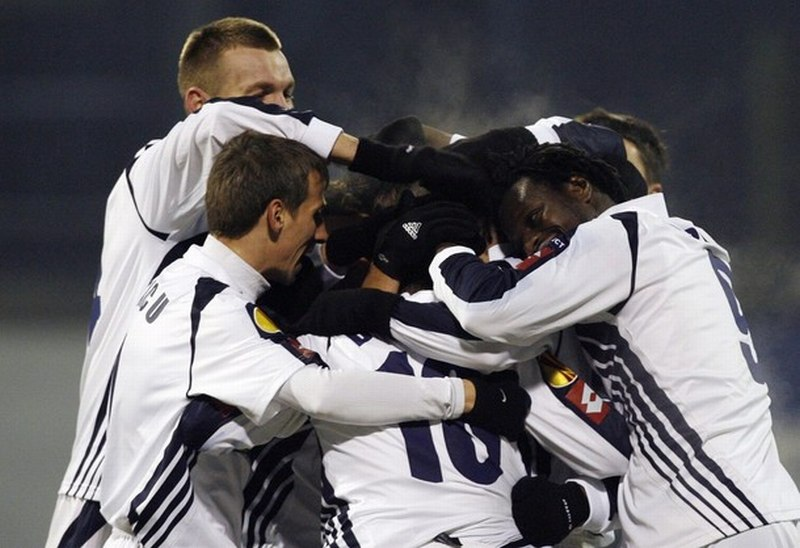 Bocur of FC Timisoara celebrates with teammates after scoring against Dinamo Zagreb during their Europa League soccer match in Zagreb